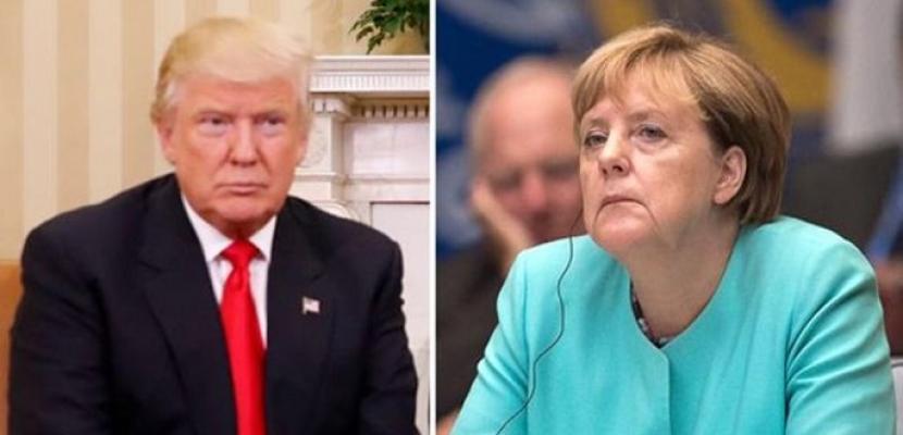 """ترامب وميركل يناقشان هاتفيا قضايا التجارة وتمويل حلف """"الناتو"""""""