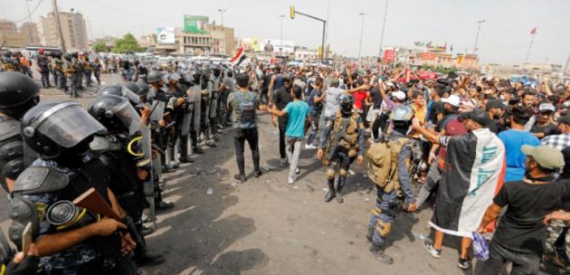 إعلان حظر التجول بعد سقوط قتلى في اشتباكات مسلحة واحتجاجات بالعراق