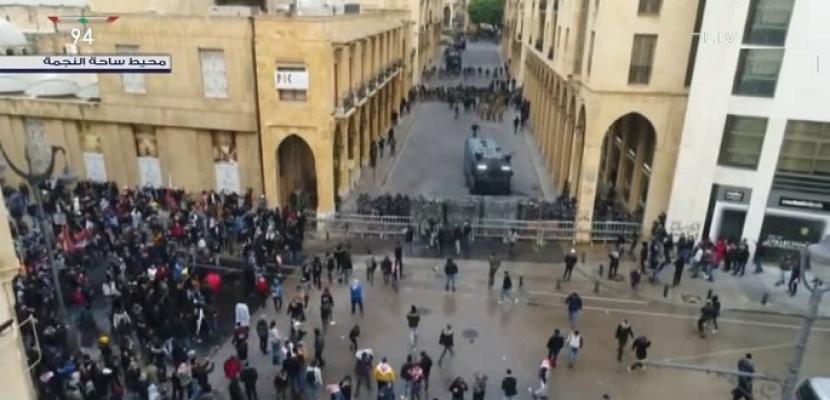 اشتباكات بين المحتجين والشرطة اللبنانية أمام مجلس النواب فى بيروت