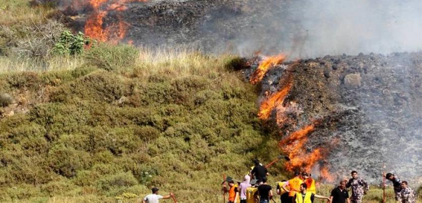 مستوطنون إسرائيليون يحرقون مساحات من أراضى بلدة فلسطينية فى نابلس